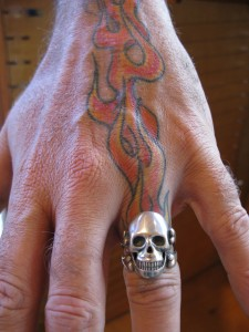 Marty's Skull Ring on Tatooed Hand
