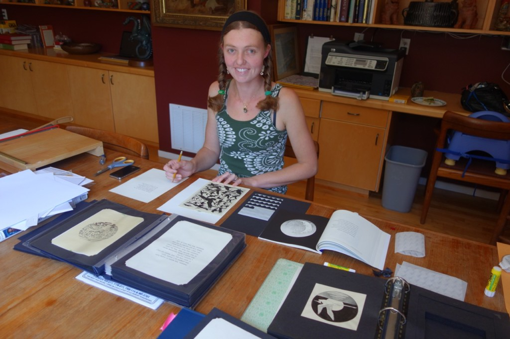 Alisha archiving the original illustrations for Cataclaysmania