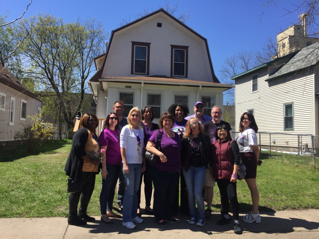 Group touring the Purple Rain House