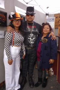 Alberto wearing the large bronze Bat on hat with Natalia and Frida