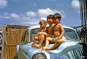 Art and his brothers atop the family car. Okinawa, 1954?